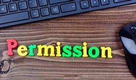 Palabra del permiso en la tabla Imagen de archivo