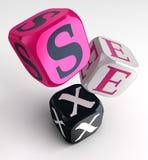 Palabra del sexo en los cubos rosados de la caja negra Foto de archivo