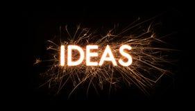Palabra del título de las IDEAS en bengala que brilla intensamente Foto de archivo