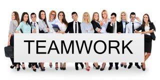 Palabra del trabajo en equipo en bandera Fotos de archivo