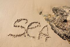 Palabra en la playa Fotos de archivo