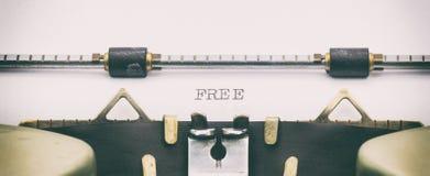 Palabra LIBRE con mayúsculas en una hoja blanca Imagenes de archivo