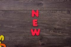 Palabra nueva de letras de madera Fotos de archivo