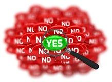 Palabra sí y no con la lupa Fotografía de archivo libre de regalías
