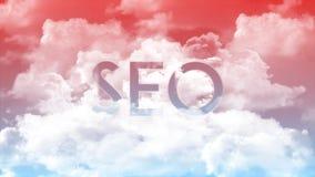 Palabra SEO en las nubes, colores rojos del cielo ilustración del vector