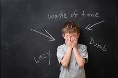 Palabras abusivas dañadas imagen de archivo libre de regalías