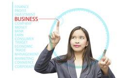 Palabras claves del negocio en el ordenador de tablero de cristal Imagen de archivo libre de regalías