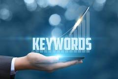 Palabras claves en el ordenador móvil Foto de archivo libre de regalías