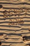 Palabras de Egipto 2016 escritas en la arena cruda en la playa Foto de archivo