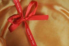 Palabras de la Feliz Año Nuevo en cinta roja Fotografía de archivo