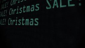 Palabras de la venta de la Navidad de la mano que mecanografían que escriben en viejo cierre llevado verde de la pantalla de la p libre illustration