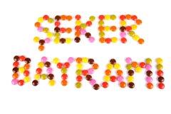 Palabras de Seker Bayrami escritas por las habas coloridas del caramelo Fotos de archivo libres de regalías