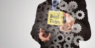 Palabras del equipo de la demostración de la mano del hombre de negocios las mejores Foto de archivo libre de regalías