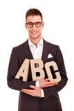 Palabras del negocio del ABC del concepto de la escritura del hombre de negocios que entrenan Imagen de archivo libre de regalías
