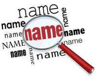 Palabras del nombre debajo de la lupa que busca a gente del hallazgo Foto de archivo libre de regalías