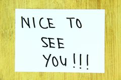 Palabras del saludo con la escritura de la mano Imagen de archivo