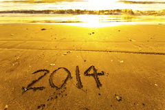 2014 palabras en la arena Imágenes de archivo libres de regalías