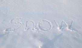 Palabras escritas en la nieve Fotos de archivo libres de regalías