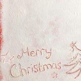 Palabras escritas Feliz Navidad en un campo de nieve, concepto del Año Nuevo Fotografía de archivo libre de regalías