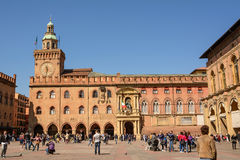 Palace of Accursio in Piazza Maggiore of Bologna with tourists o Stock Photos