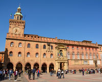 Palace of Accursio in Piazza Maggiore of Bologna with tourists o Royalty Free Stock Photos