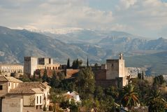 Palace of Alhambra, Granada, Spain. View of the Palace of Alhambra with snow capped mountains of the Sierra Nevada to the rear, Granada, Granada Province Stock Photos