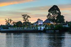 Palace Astana on the north bank of Sarawak River at sunset Stock Images