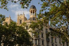 Palace behind the leaves to Barcelona in Spain Stock Photography