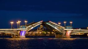Palace bridge drawing in Saint Petersburg, Russia with Peter and Paul fortress at the background at night. stock footage