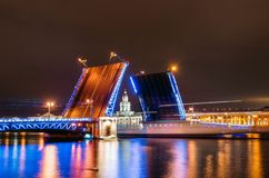The Palace Bridge and the Kunstkamera Museum at night on the Neva River In St. Petersburg. The Palace Bridge and the Kunstkamera Museum at night on the Neva Stock Photo