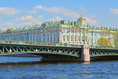 The Palace bridge through Neva in St. Petersburg, Russia. View of the Palace bridge through Neva river and Hermitage from travel ship in St. Petersburg, Russia Royalty Free Stock Photos