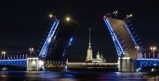 The palace bridge in St. Petersburg. Night view of the Peter and Paul Fortress stock image
