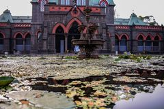 Palace capture in ground view with reflection of water stock photography