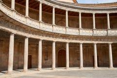 Palace Carlos V, interior circular patio.Alhambra, Spain. Palace Carlos V, interior circular patio. Rows of columns. Alhambra, Granada, Spain royalty free stock image