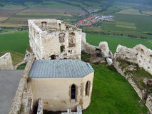 Palace and chapel at Spis castle. View of ruined palace and partially reconstructed chapel at famous Spis Castle (Spissky hrad) ruin. This castle is included in royalty free stock image