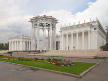 Palace from the colonnade and people walk Royalty Free Stock Photos