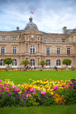 Palace and colorful flowers of Luxembourg Garden in Paris Stock Image