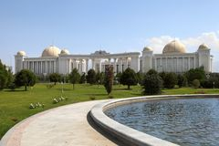 Palace with columns, domes and foutain in front. Ashkhabad. Turkmenistan royalty free stock photography