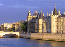 Palace Conciergerie riverside. At overcast sunset royalty free stock photos