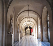 Palace Corridor , Hallway of Kings in Versailles. Sun and lamplight illumine statuary of royalty in a long arched corridor. Palace of Versailles France Stock Images