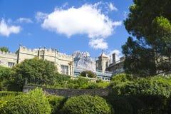 The Palace of count M.W.Vorontsov green park. Ukraine. Crimea. Ukraine. The Crimea peninsula. The park of count M.W.Vorontsov. Ai-Petri rock on background Royalty Free Stock Photography