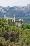 Palace in Crimea. Palace in the Crimea mountains in the background, sticking out of trees Royalty Free Stock Image