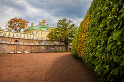 Palace with crown. Menshikov Palace with a crown surrounded by autumnal trees Stock Photography