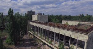 Palace of Culture Energetik in Pripyat town near Chernobyl (Aerial) stock footage