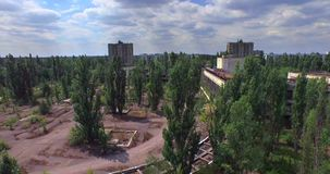 Palace of Culture Energetik in Pripyat town near Chernobyl (Aerial) stock video footage