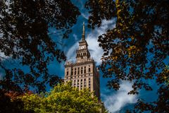 Palace of Culture and Science. Palace of Culture and Science among trees. Poland, Warsaw Stock Photo