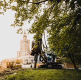 Palace of Culture and Science, Warsaw downtown. Heavy construction machinery under Palace of Culture and Science royalty free stock photo