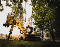 Palace of Culture and Science, Warsaw downtown. Heavy construction machinery under Palace of Culture and Science royalty free stock photos