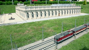 Palace de la Moneda, Chile. Electric locomotive passing by model of Palace de la Moneda, Chile placed in Minimundus in Klagenfurt, Austria stock video