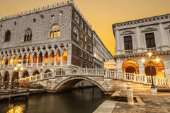 Palace of the Doges and the palazzo delle Prigioni and straw bridge at sunrise. A favorite place for walking tourists. Venice, Italy royalty free stock image